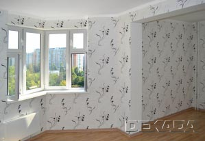 Необычная форма гостиной с порталом посередине зрительно разделяет комнату на две зоны